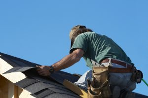 worker on roof putting shingles down, Dowell Roofing, Murfreesboro Roofers