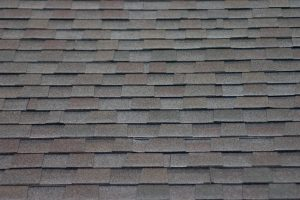 A roof made of gray asphalt shingles