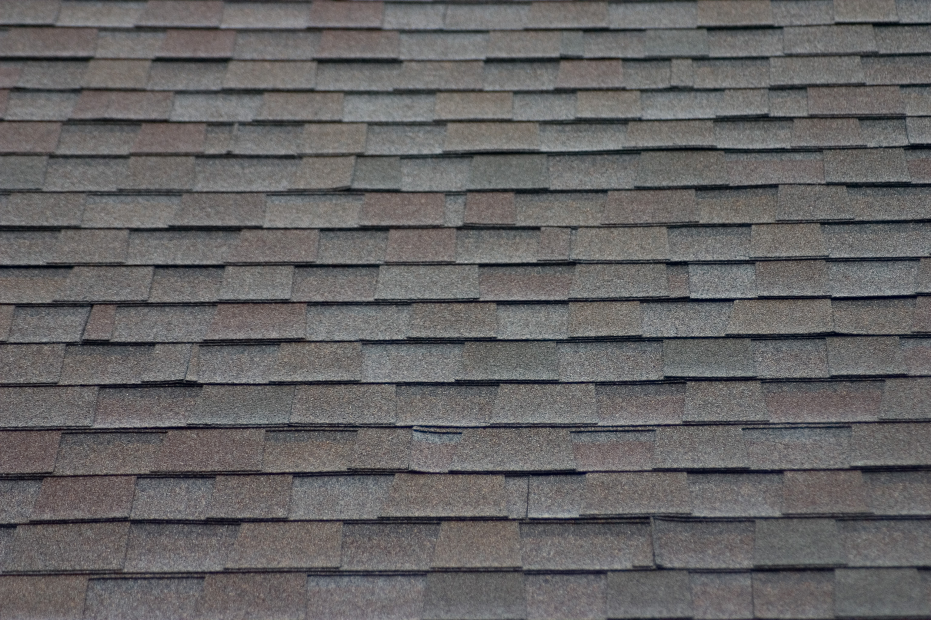 A roof made of gray asphalt shingles