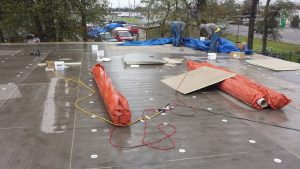 commercial roofing in the rain, Dowell Roofing, Murfreesboro Roofers